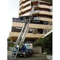 Hoist lifts_furniture_over_balcony
